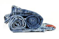 Rolled washed-out blue jeans. Two washed-out rolled blue jeans isolated on white Royalty Free Stock Image