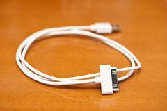 Rolled white USB cable Royalty Free Stock Photography