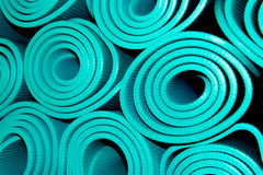 Rolled yoga mats. Gym equipment for exercise, rolled yoga mats Stock Photos