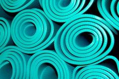Rolled yoga mats Stock Photos