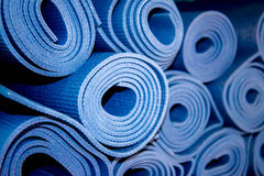 Rolled yoga mats Stock Photography