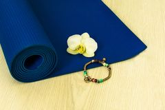 Rolled yoga or pilates mat stock photo