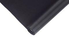 rollend zwart canvas dat op wit wordt geïsoleerd Royalty-vrije Stock Foto