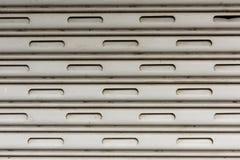 Rollenfensterladen-Türbeschaffenheit Stockfoto