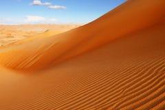 RollenSanddünen der arabischen Wüste Stockfoto