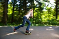 Roller. Skating at summer park Stock Photo