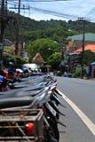 Roller auf den Straßen von asiatischen Städten Lizenzfreies Stockfoto