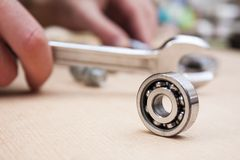 Roller bearing. And mechanic with tools royalty free stock photos