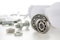Roller bearing. And mechanic with tools Stock Images