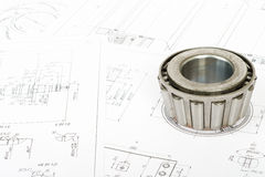 Roller bearing on blueprints. Roller bearing on blue prints, close up view Stock Photography