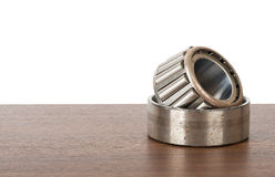 Roller bearing on table. Isolated on white background Royalty Free Stock Photography