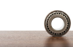 Roller bearing on table. Isolated on white background, close up Royalty Free Stock Images