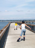 Roller Blade Siblings. Brother and Sister Rollerblading at Sea Shore Royalty Free Stock Photos