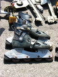 Roller Blades. Old roller blades lying in a repair shop Royalty Free Stock Photos