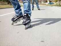 Roller-blades. Two pair of roller-blades royalty free stock photo
