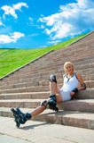 Roller blonde girl resting Royalty Free Stock Photography