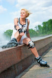 Roller blonde girl resting Stock Image
