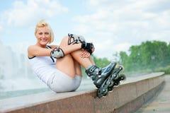 Roller blonde girl resting Stock Image