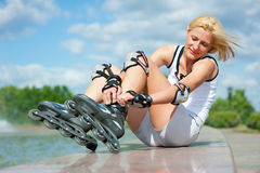Roller blonde girl resting Stock Photo