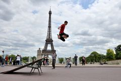 ROLLER BOY IN FRONT OF EIFFEL TOWER, PARIS Stock Photos