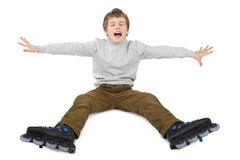 Roller boy sitting with hands at sides and crying Stock Photo