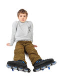 Roller boy sitting and looking at camera Royalty Free Stock Photos