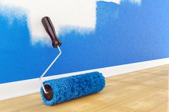 Roller brush on floor. Home interior Royalty Free Stock Photos