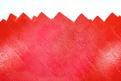 Unfinished painted wall with red color by paint roller Stock Photo