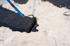 Roller brush, waterproofing Royalty Free Stock Images