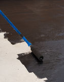 Roller brush waterproofing Royalty Free Stock Photo