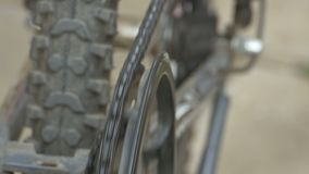 Roller Chain Running on Cog. S on bicycle stock video footage