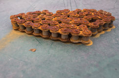 Roller chains with sprockets for conveyor line. Rusty Chains sprockets for conveyor line stock photography