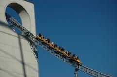 Roller coaster. Scary roller coaster ride in an amusement park Stock Photos
