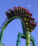 Roller coaster. Ride going upside down against blue sky Royalty Free Stock Images