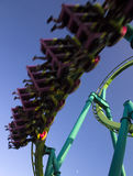 Roller coaster. Motion blurred roller coaster against blue sky royalty free stock photo