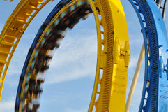 Roller Coaster. Double Loop on a Roller Coaster with train just passing royalty free stock photography