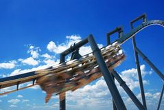 Roller coaster. On cloudy sky Royalty Free Stock Image