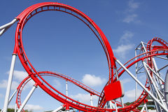 Roller coaster. Red roller coaster ride at fairground theme park royalty free stock photography