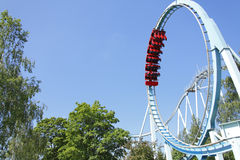 Roller coaster. Blue roller coaster ride at funfair theme park stock image