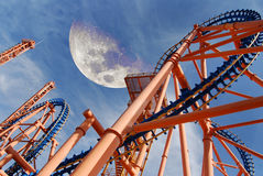 Roller-coaster 2. The structure of a roller coaster under a blue sky and the moon Stock Photography