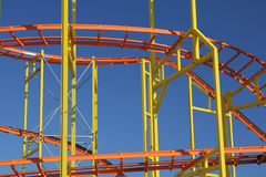 Bright Colored Roller Coaster against Blue Sky Bac Stock Photography
