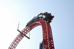 Roller coaster. The roller coaster is going to the top, with blue sky background Royalty Free Stock Image