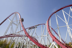 Roller coaster. Wide angle shot of a roller coaster path with car is going downward at full speed Royalty Free Stock Photos