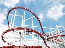 Roller of coaster against blue sky. Royalty Free Stock Photo