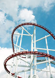 Roller of coaster against blue sky. Royalty Free Stock Images