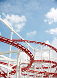 Roller of coaster against blue sky. Royalty Free Stock Photos
