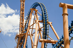 Roller coaster against blue spring sky Royalty Free Stock Images