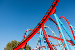 Roller Coaster in Amusement Entartainment Theme Park. At summer time royalty free stock images