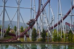 A roller coaster with an artificial lake stock photos