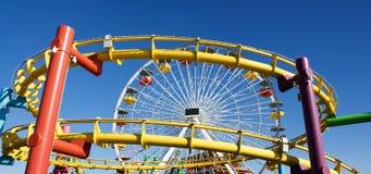 Roller coaster and big wheel Stock Photos